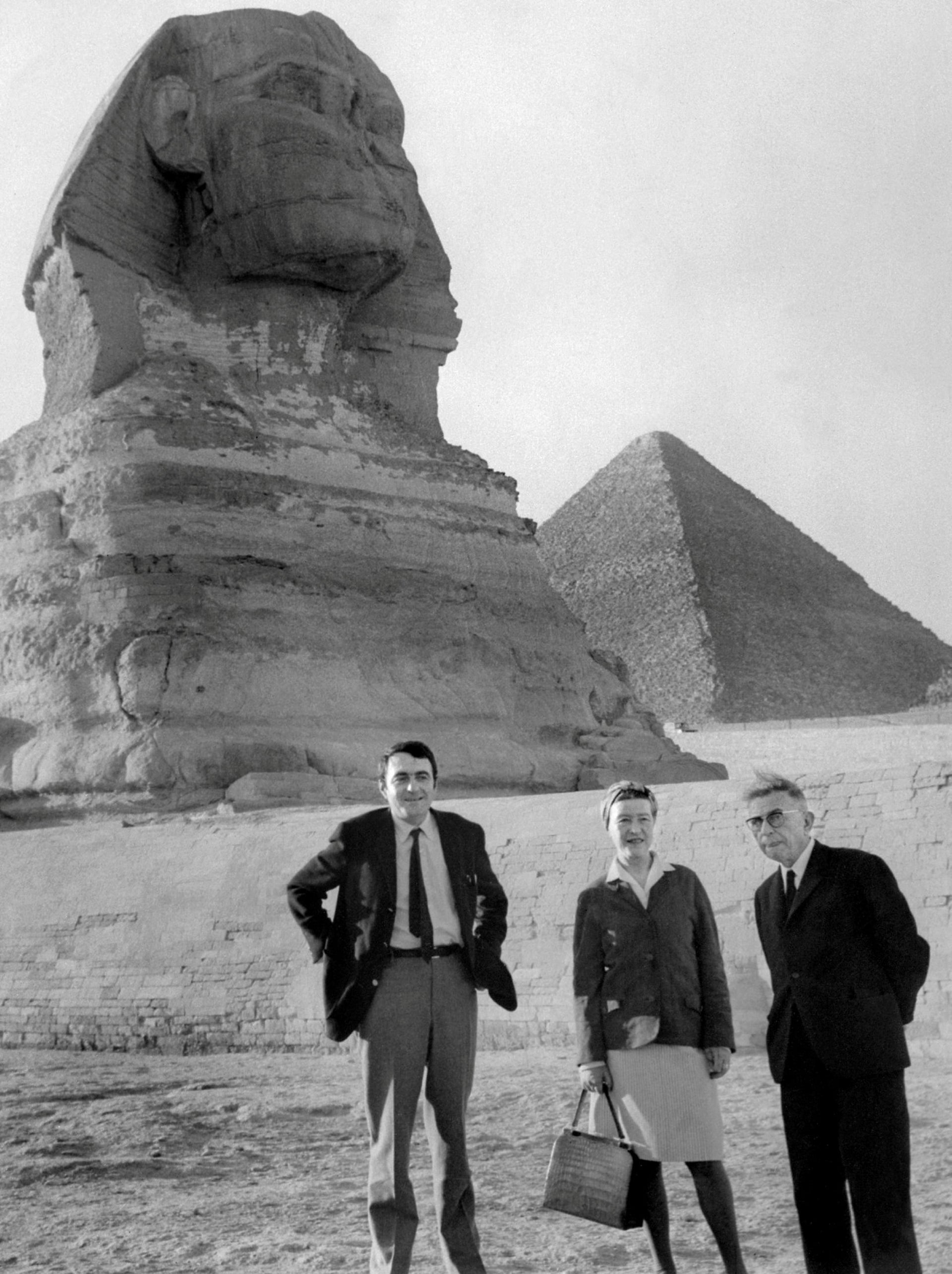 French philosopher Jean-Paul Sartre (R), French writer Simone de Beauvoir and film director Claude Lanzmann (L), visit the Pyramids in Egypt, March 4, 1967.