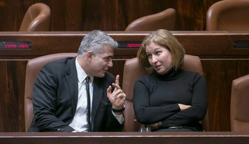 Lawmakers Yair Lapid and Tzipi Livni talk in the Knesset, Jerusalem