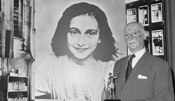In this Monday, June 14, 1971 photo Dr. Otto Frank holds the Golden Pan award, given for the sale of one million copies of the famous paperback 'The Diary of Anne Frank' in London, Great Britain.