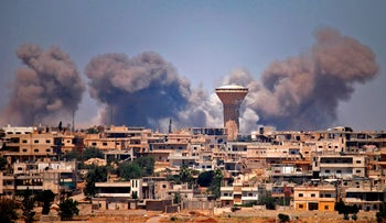 Smoke rises above rebel-held areas of the city of Daraa during reported airstrikes by the Syrian regime, July 5, 2018.