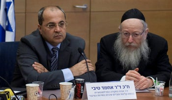 File photo: Lawmakers Ahmad Tibi and Yaakov Litzman in the Knesset.