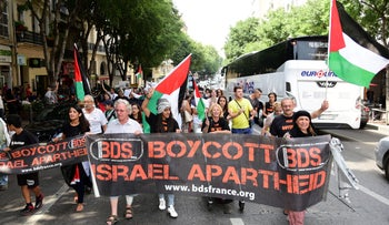 Protesters march behind a BDS banner in Marseille, France, June 13, 2015.