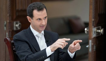 Syria's President Bashar al Assad gestures during an interview with a Greek newspaper in Damascus, Syria in this handout released May 10, 2018.