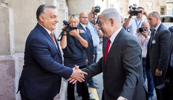 Hungarian Prime Minister Viktor Orban, left, shakes hands with Israel's  Prime Minister Benjamin Netanyahu prior to meeting of Netanyahu and the Visegrad Group's (V4) Prime Ministers in the Pesti Vigado building in Budapest, Hungary, Wednesday, July 19, 2017.