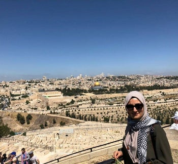 Ebru Ozkan with Dome of the Rock in the background, in Jerusalem.