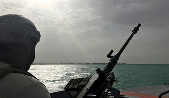UAE navy soldier patrols at Al-Mokha port in Yemen, March 6, 2018. Picture taken March 6, 2018