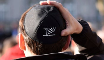 A man wears a Jewish skullcaps, or kippa, as he attends a demonstration against anti-Semitism  in Cologne, Wednesday, April 25, 2018.