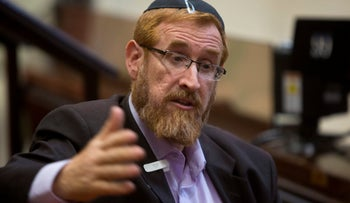 Knesset member Yehuda Glick, speaks during an interview with The Associated Press at the Knesset, Israel's parliament, in Jerusalem.