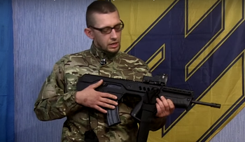 An Azov militiaman with a Tavor rifle