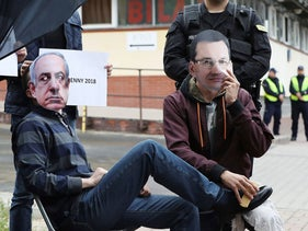 Members of a far-right group wear masks of Poland's Prime Minister Mateusz Morawiecki and Israel Prime Minister Benjamin Netanyahu at a demonstration criticizing Morawiecki for backtracking on parts of a Holocaust law, in Warsaw, July 2, 2018