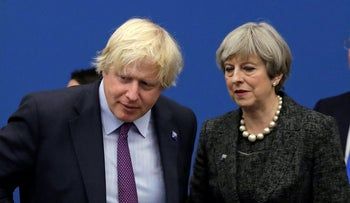 British Prime Minister Theresa May talking with then-Foreign Minister Boris Johnson at a NATO summit in Brussels, May 2017.
