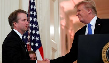 President Donald Trump shakes hands with Judge Brett Kavanaugh his Supreme Court nominee, in the East Room of the White House, Monday, July 9, 2018, in Washington.