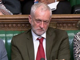 """In this video grab taken from footage broadcast by the UK Parliamentary Recording Unit (PRU) via the Parliament TV website on July 2, 2018, leader of the opposition Labour Party, Jeremy Corbyn listens as Britain's Prime Minister Theresa May answers questions after making a statement in the House of Commons on the EU summit and Brexit developments. / AFP PHOTO / PRU / Handout / RESTRICTED TO EDITORIAL USE - NO USE FOR ENTERTAINMENT, SATIRICAL, ADVERTISING PURPOSES - MANDATORY CREDIT """" AFP PHOTO / PRU """""""