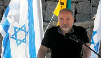 Israeli Defense Minister Avigdor Lieberman during a visit at the Israel-Syria border in the Golan Heights, July 10, 2018
