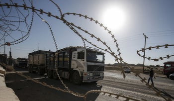 Palestinian security forces loyal to the Palestinian Authority stand at the gate of the Kerem Shalom crossing, the main passage point for goods entering Gaza, in the southern Gaza Strip town of Rafah, on July 9, 2018.