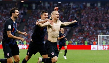 Croatia's Domagoj Vida, right, after scoring during the quarterfinal match between Russia and Croatia in Sochi, Russia, July 7, 2018.