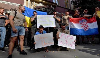 Ukrainian veterans from the war with Russia-backed separatists supporting Ukraine and Croatia outside the Croatian Embassy in Kiev on July 10, 2018.