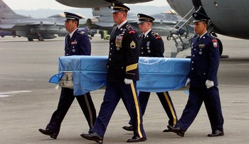 In this Friday, Sept. 2000, file photo, United Nations' soldiers carries a coffin of a missing U.S. soldier's remains upon arrival at Yokota airbase in Tokyo.