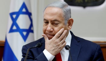 Israeli Prime Minister Benjamin Netanyahu gestures during the weekly cabinet meeting at the prime minister's office in Jerusalem, June 24, 2018