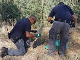 Security forces collect the wreckage of a Syrian drone that infiltrated Israeli airspace on July 11, 2018.