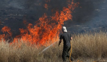 Israeli fire-fighting forces putting out a fire close to the Gaza border.