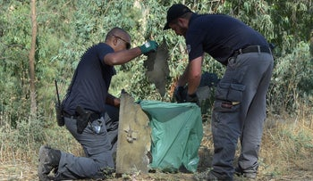 Israeli security forces collect wreckage of the Syria drone.