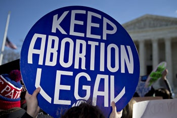 A demonstrator holds up a sign in support of abortion rights outside the U.S. Supreme Court in Washington, D.C., U.S. March 2, 2016.