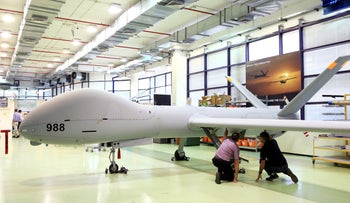 Employees check an Elbit Systems Ltd. Hermes 900 unmanned aerial vehicle (UAV) at the company's drone factory in Rehovot, Israel, June 28, 2018.