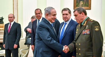 Netanyahu shakes hands with Russian Chief of the General Staff of the armed forces Valery Gerasimov as Russian President Vladimir Putin stands nearby in Moscow, Russia July 11, 2018