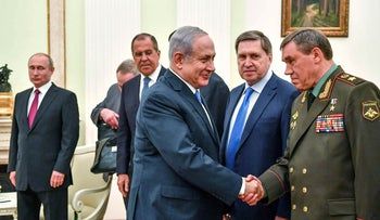 Netanyahu shakes hands with Russian Chief of the General Staff of the armed forces Valery Gerasimov at the Kremlin in Moscow, July 11, 2018