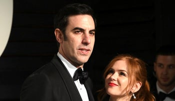 Sacha Baron Cohen, left, and Isla Fisher arrive at the Vanity Fair Oscar Party on Sunday, Feb. 28, 2016, in Beverly Hills, Calif.