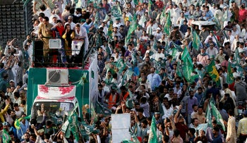 Supporters of the Pakistan Muslim League - Nawaz (PML-N) chant and march towards the airport to welcome ousted Prime Minister Nawaz Sharif and his daughter Maryam, in Lahore, Pakistan July 13, 2018