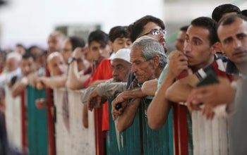 Palestinian passengers waiting to cross the border to the Egyptian side of Rafah crossing with Egypt, June 25, 2018