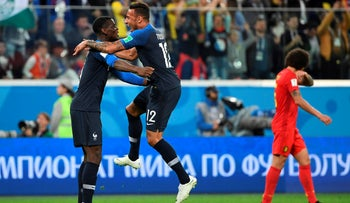 France's Paul Pogba and Corentin Tolisso celebrate the team's victory in the semi-final football match between France and Belgium, July 10, 2018