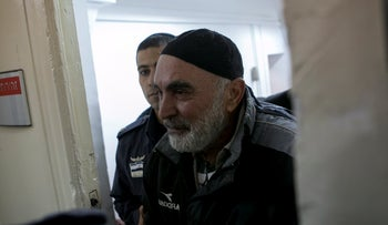 Ezra Nawi being taken to the Jerusalem Magistrate's Court in 2016.
