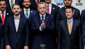 Turkey's President Erdogan with his son-in-law Berat Albayrak (left) during an election rally in Istanbul, Tuesday, May 29, 2018