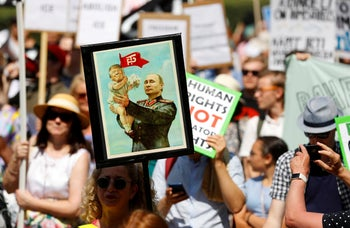 People attend 'Helsinki Calling' protest ahead of meeting between the U.S. President Donald Trump and Russian President Vladimir Putin in Helsinki, Finland. July 15, 2018