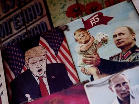Pictures depicting Russian President Vladimir Putin and U.S. President Donald Trump are displayed for sale at Izmailovsky Market at the World Cup in Moscow, Russia, July 14, 2018
