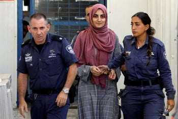 Ebru Özkan escorted by prison service guards at a military court last week.