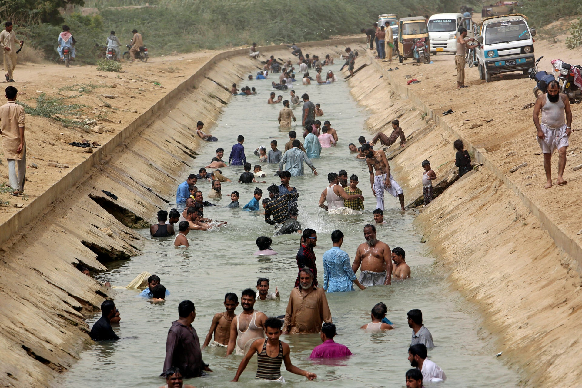 People cool themselves off in a canal  in Karachi as temperature passes 40 degrees Celsius, and that's more than 10 degrees below the heat experienced by the town of Nawabshah in April 2018. Picture taken on May 30, 2018
