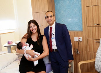 Ichilov's director-general, Prof. Rami Gamzou, and a new mom in the new ward.