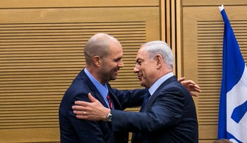 Prime Minister Benjamin Netanyahu and Amir Ohana at a Likud caucus meeting.