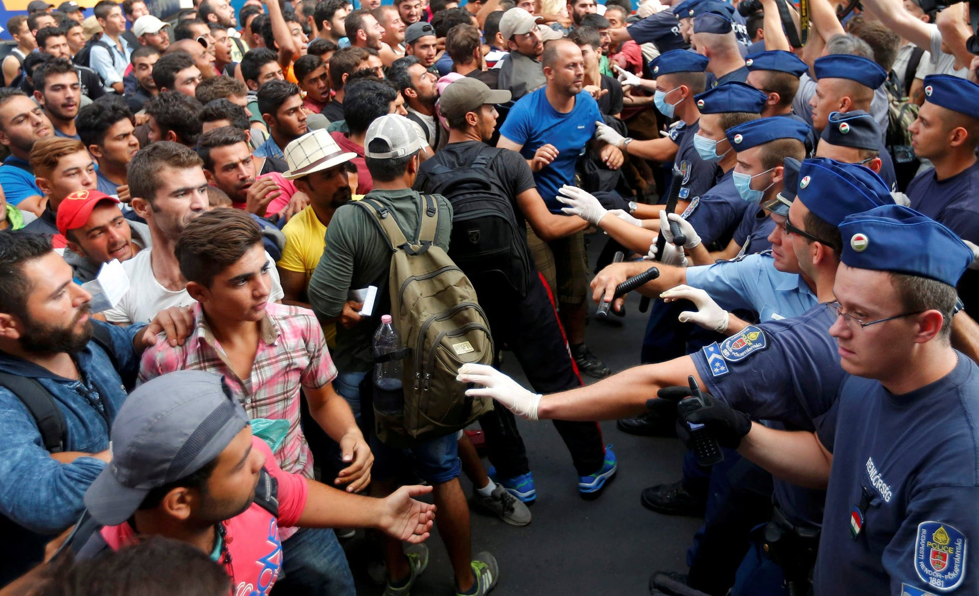 Migrants face Hungarian police in the main Eastern Railway station in Budapest, Hungary, September 1, 2015. Hungary closed Budapest's main Eastern Railway station on Tuesday morning with no trains departing or arriving until further notice, a spokesman for state railway company MAV said. There are hundreds of migrants waiting at the station. People have been told to leave the station and police have lined up at the main entrance, national news agency MTI reported.
