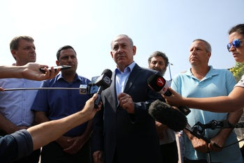 Israeli Prime Minister Benjamin Netanyahu visits Sderot, not far from Israel's border with Gaza, following a surge in mortar shell and rocket fire aimed at the southern part of the country from the Strip, July 16, 2018.