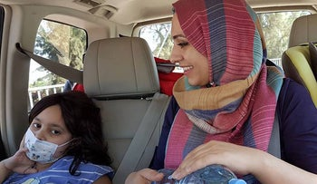 A Palestinian mother and her children during a Road to Recovery journey to an Israeli hospital.
