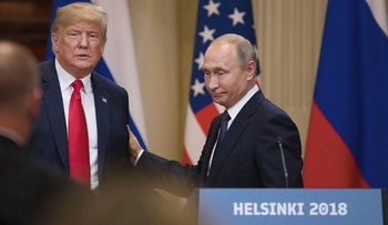 U.S. President Donald Trump, left, and Vladimir Putin, Russia's president, prepare to leave following a news conference in Helsinki, Finland, on Monday, July 16, 2018