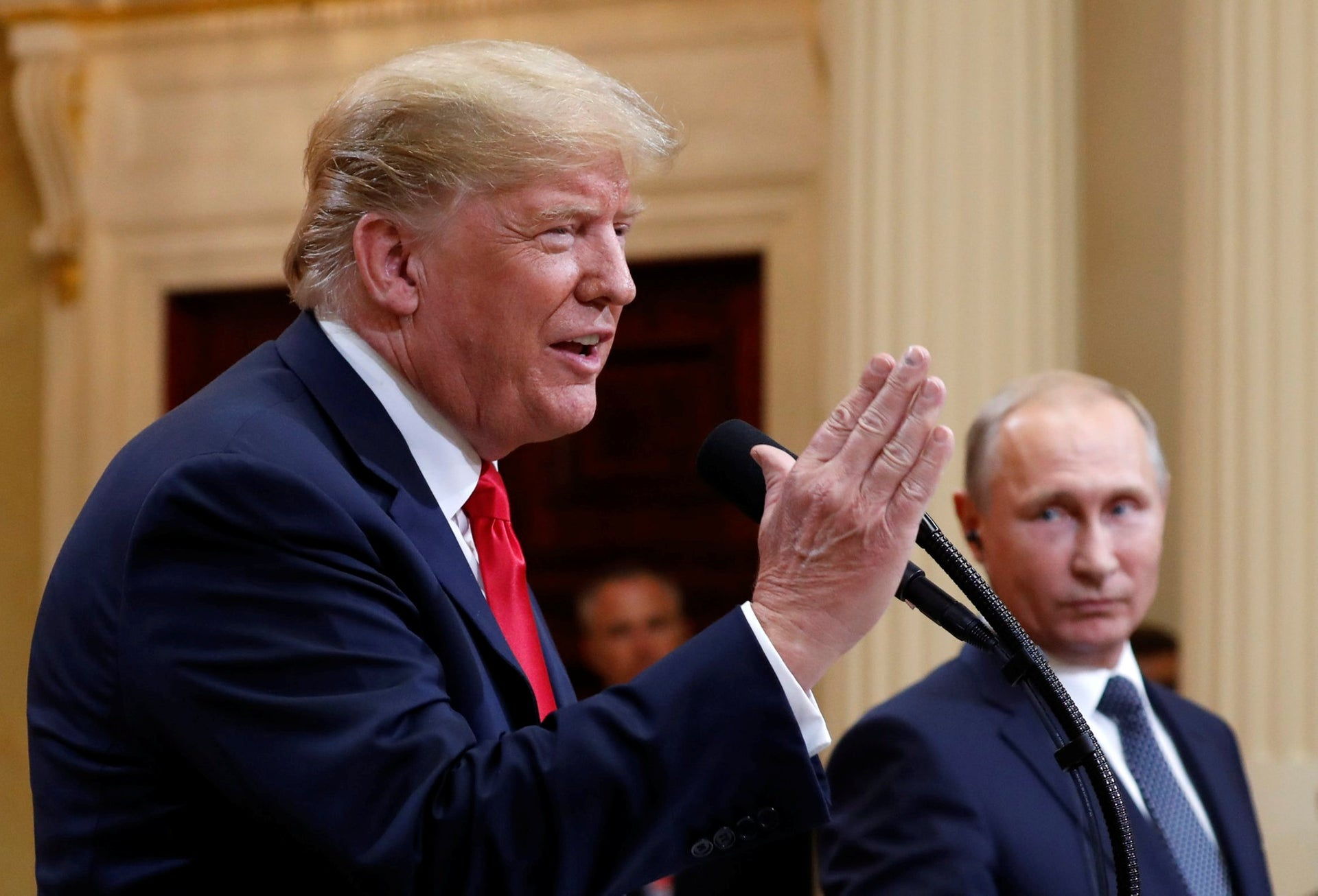 U.S. President Donald Trump speaking with Russian President Vladimir Putin during a press conference after their meeting at the Presidential Palace in Helsinki, Finland, July 16, 2018.