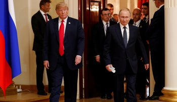 U.S. President Donald Trump and Russia's President Vladimir Putin arrive to hold a joint news conference after their meeting in Helsinki, July 16, 2018
