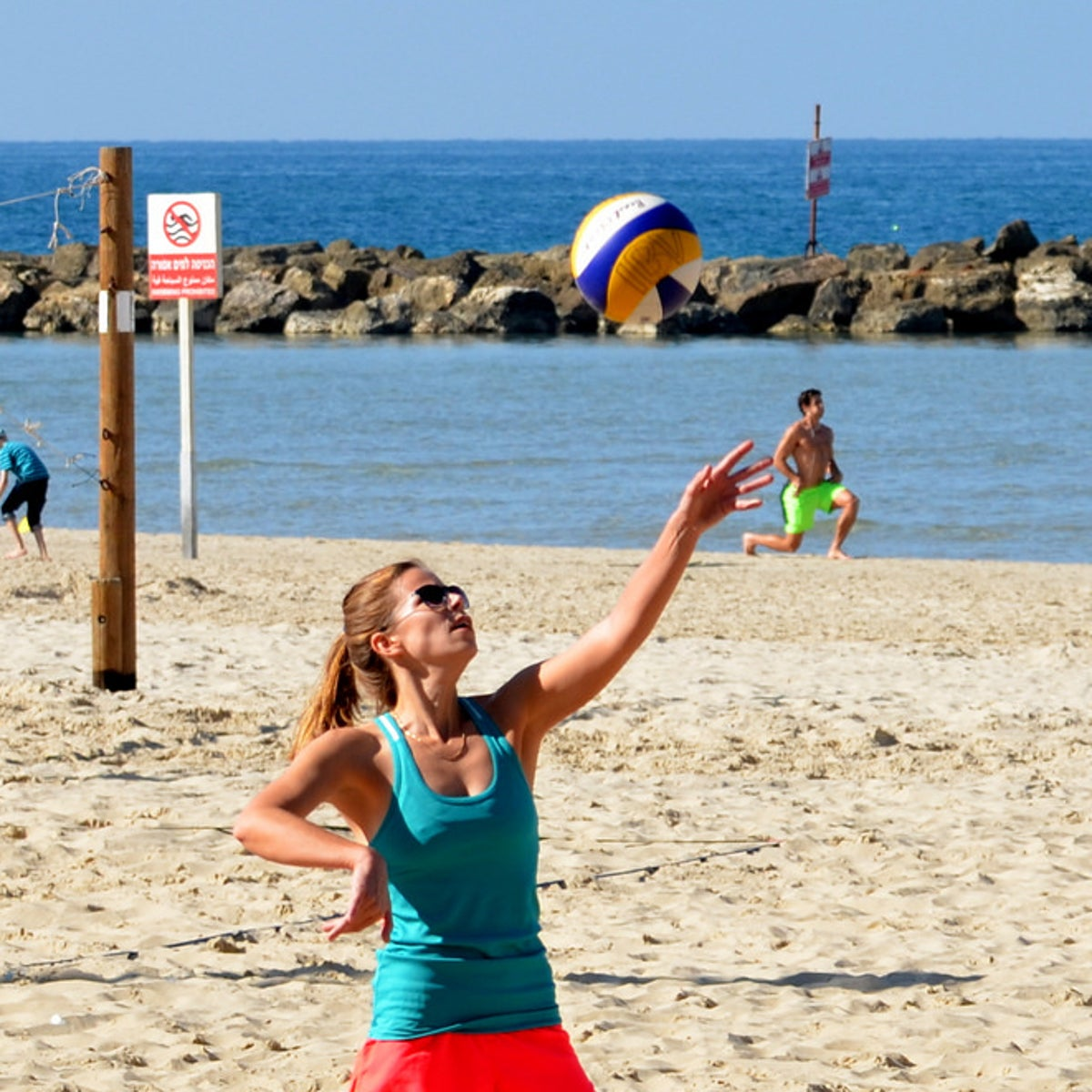 Playing volleyball on the beach in Tel Aviv-Jaffa.