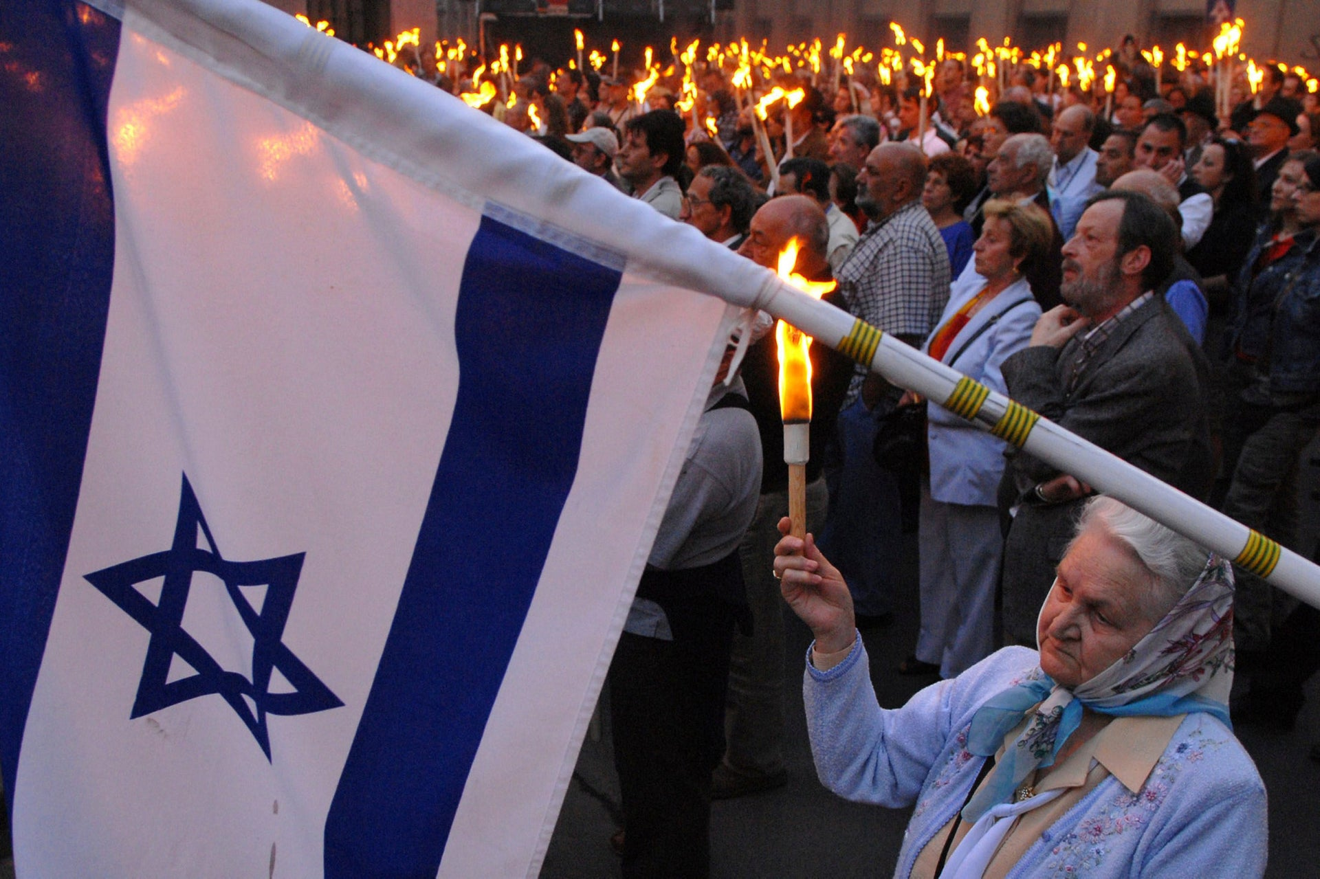 An Israeli flag is seen as thousands gather together for the March of Life to remember for the victims of the Holocaust in front of the Dohany street synagogue in Budapest, Hungary Sunday, April 15, 2007. Today is the official memorial day for the more then 600,000 victims of the Hungarian Holocaust marking the day when members of the Hungarian Nazi party shot Jews into the River Danube during WWII.